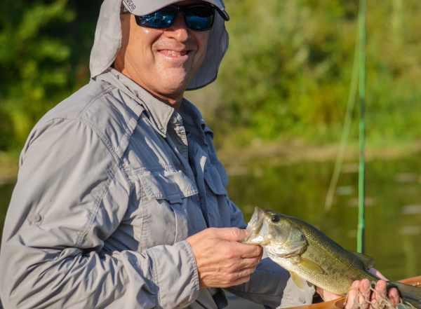 Darin Beesley with bass caught on classic destiny custom rod
